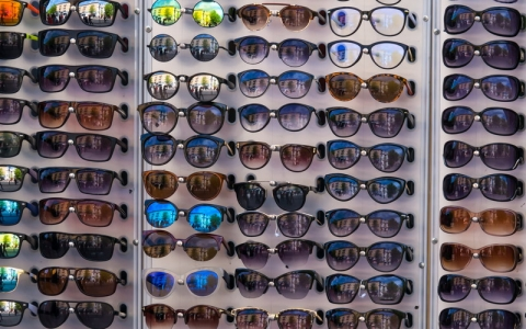 many different sunglasses in a store on the market